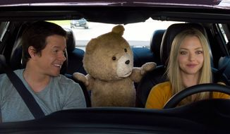 "In this image released by Universal Pictures, Mark Wahlberg , from left, the character Ted, voiced by Seth MacFarlane, and Amanda Seyfried appear in a scene from ""Ted 2."" (Universal Pictures via AP)"