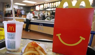This Jan. 20, 2012, file photo shows a Happy Meal with french fries and a drink at a McDonald's, in Springfield, Ill. (AP Photo/Seth Perlman, File) ** FILE **