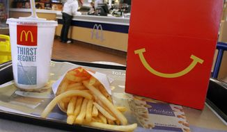 This Jan. 20, 2012, file photo shows a Happy Meal with french fries and a drink at a McDonald's, in Springfield, Ill. (AP Photo/Seth Perlman, File)