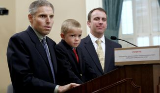 Carl Krawitt, left,  a supporter of a measure requiring nearly all of California school children to be vaccinated, answers a question during news conference at the Capitol in Sacramento, Calif., Wednesday, April 15, 2015. Krawitt's said he had worried about son Rhett, 7, center, who was unable to be vaccinated while receiving treatment for leukemia. At right is Assemblyman Marc Levine,B-San Rafeal, a supporter of the measure and whose district the Krawitts live. The state Assembly is expected to vote on the bill, Thursday. (AP Photo/Rich Pedroncelli)
