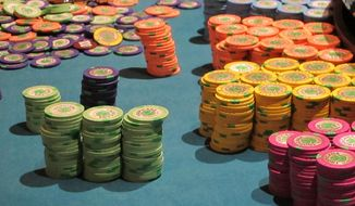 This April 17, 2015 photo shows stacks of gambling chips on a roulette table at the Tropicana Casino and Resort in Atlantic City N.J.  A package of five bills to assist Atlantic City and its struggling casinos was to be voted upon by the New Jersey Legislature on Thursday June 25, 2015. The most significant of them would allow casinos to make payments in lieu of taxes for 15 years. (AP Photo/Wayne Parry)