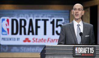 NBA Commissioner Adam Silver announces Karl-Anthony Towns as the overall first pick by the Minnesota Timberwolves during the NBA basketball draft, Thursday, June 25, 2015, in New York. (AP Photo/Kathy Willens) **FILE**