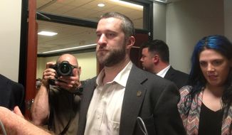 In this May 29, 2015, file photo, television actor Dustin Diamond, center, leaves court in Port Washington, Wisconsin, after being convicted of two misdemeanors stemming from a barroom fight on Christmas Day 2014. Diamond is set to be sentenced Thursday, June 25, 2015. (AP Photo/Dana Ferguson, File)