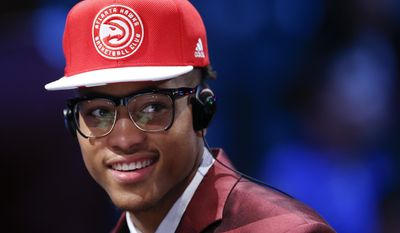 Kelly Oubre Jr. answers questions during an interview after being selected 15th overall by the Atlanta Hawks during the NBA basketball draft, Thursday, June 25, 2015, in New York. (AP Photo/Kathy Willens)