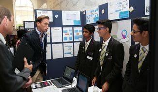 Muaz Nawaz, 13, Daanyaal Ali, 14, and Chirag Shah, 14, of London's Isaac Newton Academy have been approached by a condom manufacturer after their idea helped them win the 2015 TeenTech Awards. The boys hope to create a condom that turns different colors depending on what sexually transmitted disease it is exposed to during intercourse. (Image: Teen Tech Awards screenshot) ** FILE **