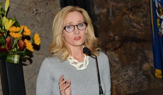 In this April 9, 2015, file photo, Author J.K. Rowling speaks at the Empire State Building during a lighting ceremony and to mark the launch of her nonprofit children's organization Lumos in New York. (Photo by Evan Agostini/Invision/AP)