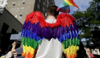 A demonstrator arrives at a rally in Greenwich Village to celebrate the Supreme Court's ruling on gay marriage, Friday, June 26, 2015, in New York. The Supreme Court declared that same-sex couples have a right to marry anywhere in the U.S.  (AP Photo/Julie Jacobson) ** FILE **