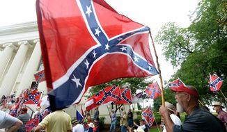 Supporters gather for a rally to protest the removal of Confederate flags from the Confederate Memorial Saturday, June 27, 2015, in Montgomery, Ala.   (Julie Bennett/AL.com via AP) MAGS OUT; MANDATORY CREDIT