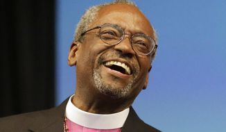 Bishop Michael Curry of North Carolina, smiles after being elected the Episcopal Church's first African-American presiding bishop at the Episcopal General Convention Saturday, June 27, 2015, in Salt Lake City. Curry won the vote in a landslide. (AP Photo/Rick Bowmer)