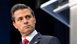 Mexico's President Enrique Pena Nieto addresses the media during an EU Mexico summit at the EU Council building in Brussels, in this June 12, 2015, file photo. (AP Photo/Geert Vanden Wijngaert, File)