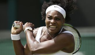 Serena Williams of the United States plays a return to Margarita Gasparyan of Russia during their women's singles first round match at the All England Lawn Tennis Championships in Wimbledon, London, Monday June 29, 2015. (AP Photo/Pavel Golovkin)