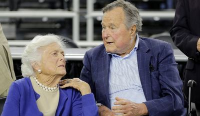 """Former President George H.W. Bush is pitching for presidential campaign cash on behalf of son Jeb and warns supporters in jest that his wife, Barbara, is """"The Enforcer."""" """"Trust me, you don't want her following up,"""" he said. (Associated Press)"""