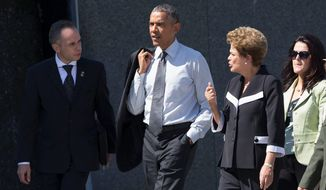 President Obama took Brazilian President Dilma Rousseff (second from right) on a visit to the Martin Luther King Jr. Memorial in Washington. Ms. Rousseff's trip is also taking place as the world's seventh-largest economy is falling into recession, struggling to balance its national budget and desperately seeking foreign investment. (Associated Press)