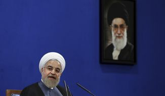 In this Saturday, June 13, 2015 file photo, Iranian President Hassan Rouhani speaks during a press conference on the second anniversary of his election in Tehran, Iran. A picture of the supreme leader Ayatollah Ali Khamenei hangs on the wall. Should the talks over Iran's nuclear program collapse, the alternatives are not appealing: The war option that the United States has kept on the table has few fans, and the world does not seem willing to truly bring Iran to its knees by shutting off the flow of capital and goods. (AP Photo/Ebrahim Noroozi, File)