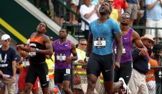 Justin Gatlin, front right, reacts after winning the 200-meter at the U.S. track and field championships in Eugene, Ore., Sunday, June 28, 2015. (AP Photo/Ryan Kang)