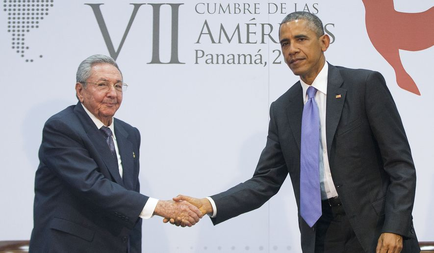 President Obama and Cuban President Raul Castro shake hands during their meeting at the Summit of the Americas in Panama City, Panama, in this April 11, 2015, file photo. (Associated Press) ** FILE **