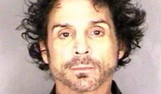 This June 14, 2015, booking photo provided by the Marion County Sheriff's office taken shows Deen Castronovo, drummer for rock band Journey, in Salem, Ore. (Associated Press)