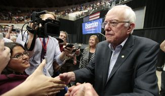 Democratic presidential candidate, Sen. Bernie Sanders shakes hands with supporters after speaking at a political rally in Madison, Wis., Wednesday, July 1, 2015. (Michael P. King/Wisconsin State Journal via AP)