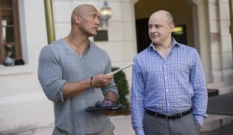 "In this image released by HBO, Dwayne Johnson, left, and Rob Corddry appear in a scene from the series ""Ballers,"" airing Sundays at 10 p.m. EDT on HBO. (Jeff Daly/HBO via AP)"