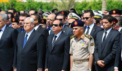 In this picture provided by the office of the Egyptian Presidency, Egyptian president Abdel-Fattah el-Sissi, center front, Minister of Defense Sedki Sobhi, center right and former acting Egyptian president Adly Mansour, second left, attend the military funeral of Hisham Barakat  the top judicial official in charge of overseeing the prosecution of thousands of Islamists, including former President Mohammed Morsi in Cairo, Egypt, Tuesday, June 30, 2015.  (Egyptian Presidency via AP)