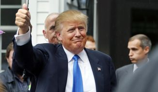 Republican presidential candidate Donald Trump waves as he arrives at a house party Tuesday, June 30, 2015, in Bedford, N.H. (AP Photo/Jim Cole) ** FILE **