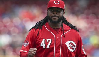 Cincinnati Reds starting pitcher Johnny Cueto reacts in the sixth inning of a baseball game against the Minnesota Twins, Wednesday, July 1, 2015, in Cincinnati. The Reds won 2-1. (AP Photo/John Minchillo)