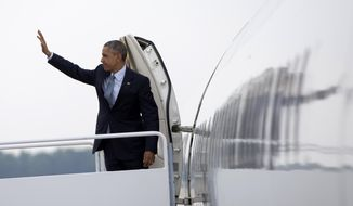 President Obama waves as he boards Air Force One, Thursday, July 2, 2015, at Andrews Air Force Base, Md., en route to La Crosse, Wis., where he is to speak at the University of Wisconsin at La Crosse about economy and to promote a proposed Labor Department rule that would make more workers eligible for overtime. (AP Photo/Carolyn Kaster)