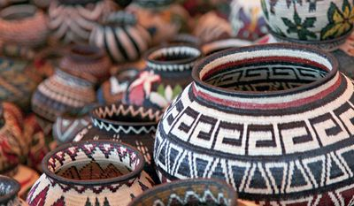 Handwoven baskets from the Wounaan National Congress in Panama at the International Folk Art Market in Santa Fe, N.M. This year's annual market begins July 10, 2015. (Stephanie Mendez/International Folk Art Market via AP)