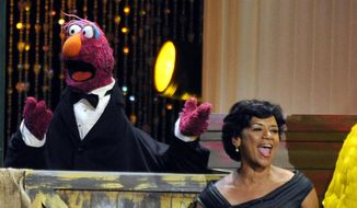 "Actress Sonia Manzano, right, performs at the Daytime Emmy Awards in Los Angeles in this Aug. 30, 2009, file photo. Manzano, who has played the role of Maria on the groundbreaking kid show ""Sesame Street"" since 1971, is retiring. (AP Photo/Chris Pizzello, File)"