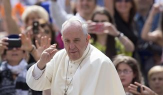 Pope Francis waves to the faithful as he arrives for his weekly general audience, in St. Peter's Square, at the Vatican in this June 24, 2015, file photo. (AP Photo/Riccardo De Luca, File)