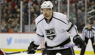 Los Angeles Kings right wing Justin Williams (14) gets into position for a face-off during the second period of an NHL hockey game against the Minnesota Wild in St. Paul, Minn., Wednesday, Nov. 26, 2014.   (AP Photo/Ann Heisenfelt)