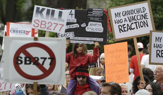 Protesters against a measure requiring California schoolchildren to get vaccinated rally at the Capitol in Sacramento on April 8. (Associated Press)