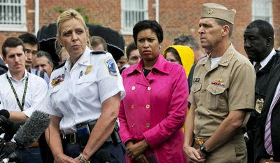 Washington Police Chief Cathy Lanier, left, with Washington Mayor Muriel Bowser, center, and Vice Admiral Dixon Smith, head of Navy Installations Command, speaks to the media during a news conference about the Navy Yard, Thursday, July 2, 2015, in Washington. (AP Photo/Jacquelyn Martin)