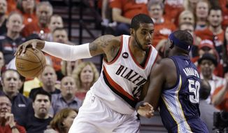 FILE - In this Monday, April 27, 2015 file photo, Portland Trail Blazers forward LaMarcus Aldridge, left, works the ball in against Memphis Grizzlies forward Zach Randolph during the first half of Game 4 of a first-round NBA basketball playoff series in Portland, Ore. A person with knowledge of the negotiations says LaMarcus Aldridge and the Miami Heat have spoken about his future plans, and that a formal conversation is scheduled for Thursday night, July 2, 2015.  (AP Photo/Don Ryan, File)