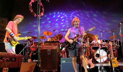 In this Aug. 3, 2002, file photo, The Grateful Dead, from left, Phil Lesh, Bill Kreutzmann, Bob Weir and Mickey Hart perform during a reunion concert in East Troy, Wis. (AP Photo/Morry Gash, File)