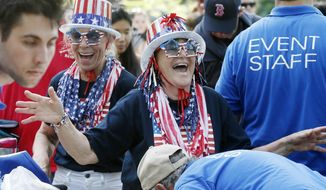 July Fourth revelers are encouraged to enjoy their celebrations but are told to expect heightened security. (Associated Press/File)