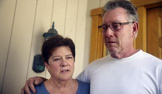 Liz Sullivan (left) and Jim Steinle, parents of Kathryn Steinle, talk to members of the media outside their home in Pleasanton, Calif., on July 2, 2015. Kathryn Steinle was shot to death, apparently at random, while walking with her father and a friend along a popular pedestrian pier on the San Francisco waterfront on July 1. The woman was shot Wednesday evening at Pier 14 and died at a hospital. (Lea Suzuki/San Francisco Chronicle via Associated Press)