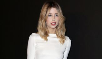 FILE - In this Tuesday, Feb. 25, 2014 file photo, Peaches Geldof arrives to attend the ETAM's ready to wear fall/winter 2014-2015 fashion collection presented in Paris. British police say they have closed an investigation into who supplied Peaches Geldof with the heroin that killed her. The 25-year-old TV personality, daughter of Live Aid organizer Bob Geldof, was found dead at her home outside London on April 7, 2014. (AP Photo/C. d'Ettorre, File)