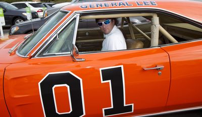 "In this Feb. 1, 2012, file photo, golfer Bubba Watson drives off in the General Lee after playing in the pro-am at the Phoenix Open golf tournament in Scottsdale, Ariz. Bubba Watson says he's painting over the Confederate flag on his car made popular in ""The Dukes of Hazzard"" television series. Watson said Friday, July 3, 2015, he'll replace it with the U.S. flag on the roof of the ""General Lee 01."" (AP Photo/The Arizona Republic, Rob Schumacher, File)"