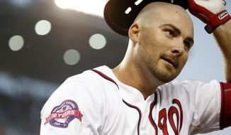 Washington Nationals first baseman Clint Robinson (25) smiles after his two-run homer during a baseball game against the San Francisco Giants at Nationals Park, Friday, July 3, 2015, in Washington. The Nationals won 2-1. (AP Photo/Alex Brandon)