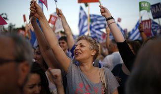 Demonstrators shout slogans during a rally organized by supporters of the Yes vote in Athens, Friday, July 3, 2015. A new opinion poll shows a dead heat in Greece's referendum campaign with just two days to go before Sunday's vote on whether Greeks should accept more austerity in return for bailout loans. (AP Photo/Emilio Morenatti)