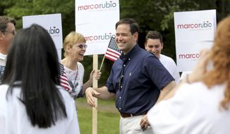Republican presidential candidate Sen. Marco Rubio, R-Fla., smiles as he greets his supporters as he arrives to the staging area for the Fourth of July parade, Saturday, July 4, 2015, in Wolfeboro, N.H. (AP Photo/Mary Schwalm) ** FILE **
