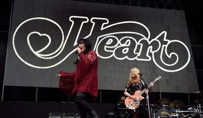 Ann Wilson, left, and Nancy Wilson of the band Heart performs at RFK Stadium on Saturday, July 4, 2015, in Washington. (Photo by Nick Wass/Invision/AP)