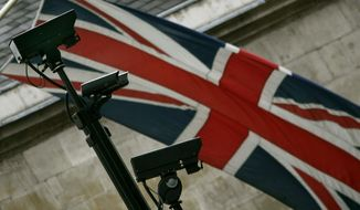 "FILE - In this July 26 2005 file photo, a closed-circuit surveillance cameras, with a Union flag at rear, keeps watch in central London. After four home-grown suicide bombers killed 52 London commuters on July 7, 2005, Prime Minister Tony Blair vowed that Britain would stop at nothing to defeat terrorism. ""Let no one be in any doubt,"" he said. ""The rules of the game are changing."" Since the Sept. 11 attacks in the United States four years earlier, Britain had made its anti-terrorism powers among the toughest in the Western world. Now they became tougher still. ""What 7/7 did was it made people realize that the threat was internal as well as external,"" said David Anderson, Britain's official reviewer of terrorism legislation.  (AP Photo/Lefteris Pitarakis)"