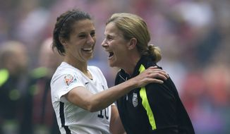 United States coach Jill Ellis, right, and Carli Lloyd celebrate after they defeated Japan 5-2 in the FIFA Women's World Cup soccer championship in Vancouver, British Columbia, Canada, Sunday, July 5, 2015. (Darryl Dyck/The Canadian Press via AP) MANDATORY CREDIT