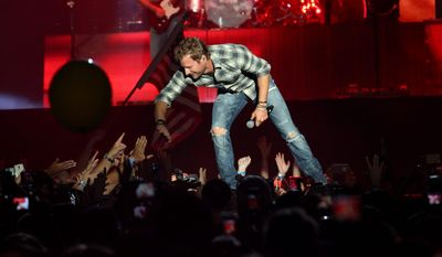 "Dierks Bentley's ""Riser"" was written, in part, with Mr. Bentley's father in mind. Leon Bentley, who died in 2012, was a major country music fan whose influence guided his son in many ways, including toward all things country. Mr. Bentley performs at Jiffy Lube Live on Friday. (Associated Press)"