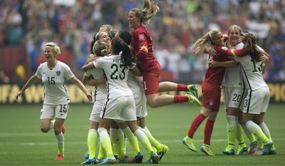 United States players celebrate after they defeated Japan 5-2 in the FIFA Women's World Cup soccer championship in Vancouver, British Columbia, on Sunday. (The Canadian Press via AP)