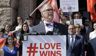 Jim Obergefell, the named plaintiff in the Obergefell v. Hodges, is backed by supporters on the steps of the Texas Capitol during a rally in Austin on June 29, 2015. The Supreme Court declared that same-sex couples have a right to marry anywhere in the United States on June 26, 2015. (AP Photo/Eric Gay. File photo) ** FILE **