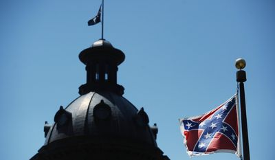 FILE - In this June 19, 2015 file photo, the Confederate flag flies near the South Carolina Statehouse in Columbia, S.C. The General Assembly returns Monday, July 6, 2015, to discuss what to do with the rebel flag that has flown over some part of the Statehouse for more than 50 years. (AP Photo/Rainier Ehrhardt, File)