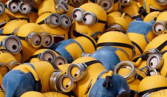 "In this image released by Universal Pictures, various minion characters appear in a scene from the animated feature, ""Minions."" (Illumination Entertainment/Universal Pictures via AP)"